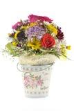 Il secchio del metallo con i fiori fotografia stock libera da diritti