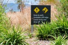 Il segnale di pericolo si attiene al percorso Fotografia Stock