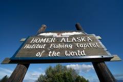 Il segno accoglie favorevolmente gli ospiti a Homer Alaska sulla penisola di Kenai immagini stock