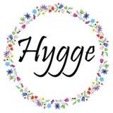 Il segno di Hygge che simbolizza lo stile di vita danese circondato entro la molla variopinta ha ispirato il cerchio circondato d illustrazione di stock