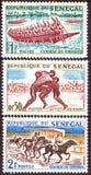 IL SENEGAL - CIRCA 1961: i bolli stampati nel Senegal mostra i concorsi negli sport nazionali, circa gli anni 60 fotografia stock