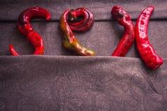 Il sesso di parola di pepe fotografie stock