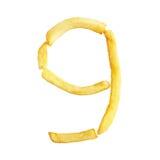 Il simbolo 9 di numero nove è fatto delle patate fritte Fotografia Stock