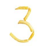 Il simbolo 3 di numero tre è fatto delle patate fritte Fotografia Stock