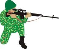 Il soldato con un fucile Fotografia Stock