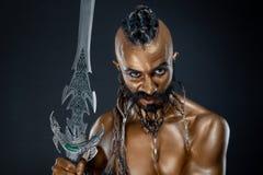 Il soldato potente dell'oro con la spada 6 Immagini Stock Libere da Diritti