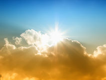 Il sole e le nubi Fotografie Stock