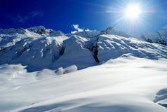 Il sole nelle montagne Fotografia Stock
