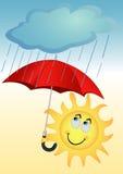 Il sole sotto un ombrello Fotografie Stock