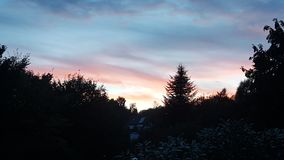 Il sole va giù Fotografia Stock