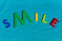 Il sorriso di parola composto dalle lettere fotografia stock