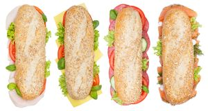 Il sottomarino interpone le intere baguette dei grani con il sal del formaggio del salame del prosciutto Fotografie Stock