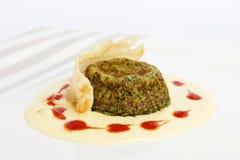 Il soufflè degli spinaci con la crema del formaggio quattro ed il parmigiano crust Fotografia Stock Libera da Diritti