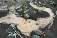 IL and stones on bottom of river Studenaya. Kamchatka Peninsula. Stock Image