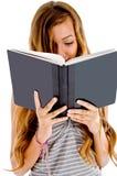 il suo allievo della lettura del taccuino Immagini Stock