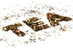 Il tè di parola compitato con tè Fotografie Stock Libere da Diritti