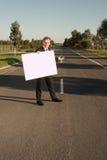 Il tabellone per le affissioni dell'uomo d'affari invita Fotografia Stock