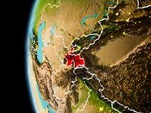 Il Tagikistan da spazio nella sera Fotografia Stock