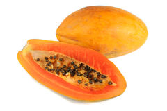 Il taglio mezzo e l'intera papaia fruttifica su priorità bassa bianca Immagine Stock Libera da Diritti