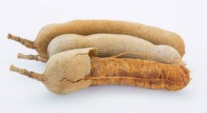 Il tamarindo dolce per il cibo sul fondo bianco Fotografia Stock