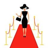 Il tappeto rosso ed il cancello girevole dorato dei sostegni della barriera della corda hanno isolato la donna in black hat, bors Immagini Stock
