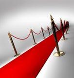 Il tappeto rosso su 3d bianco rende Fotografia Stock