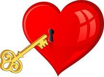 Il tasto dorato apre il cuore Fotografie Stock