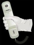 Il telefono bianco della stretta del guanto della mano Immagine Stock Libera da Diritti
