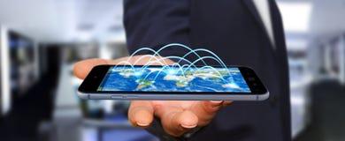 Il telefono cellulare della tenuta dell'uomo d'affari con collegamento a Internet 3D ren Immagini Stock