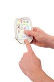 Il telefono cellulare di carta in mani degli uomini Fotografia Stock