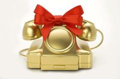 Il telefono di colore dell'oro con una burocrazia. Fotografia Stock