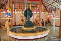 Il tempio in Tailandia là è un bello Buddha Scultura antica di legno Wat Thai Samakkhi, Mae Sot District, Tak Province Immagini Stock Libere da Diritti