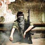 Il terrorista arabo munito della donna Fotografia Stock Libera da Diritti