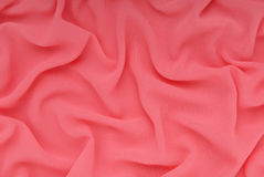 Il tessuto ha fucsia di colore, ambiti di provenienza strutturati Fotografia Stock