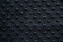 Il tessuto scuro con i punti si chiude su fondo Immagine Stock Libera da Diritti