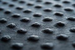 Il tessuto scuro con i punti si chiude su fondo Fotografia Stock Libera da Diritti