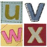 Il tessuto segna la raccolta con lettere Immagine Stock