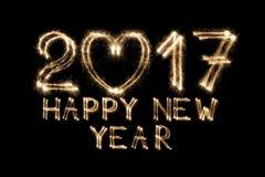Il testo del nuovo anno, stella filante numera su fondo nero Fotografie Stock
