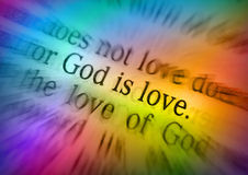Il testo DIO della bibbia È AMORE - 1 4:8 di John fotografia stock libera da diritti
