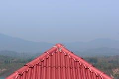 Il tetto rosso guarda il triangolo in Tailandia immagini stock libere da diritti