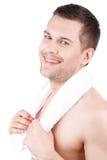 Il tipo nudo attraente è preoccuparsi del suo aspetto fotografia stock
