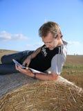 Il tirante sta leggendo fotografia stock