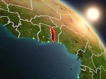 Il Togo da spazio durante l'alba Fotografia Stock Libera da Diritti