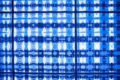 Il tono blu astratto ha macchiato il fondo della carta da parati di struttura del pixel del mosaico Immagine Stock