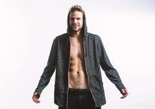 Il torso muscolare sexy dei pantaloni a vita bassa decolla i vestiti Sensibilit? macho seducente sexy Desiderio liberato Ente sex fotografia stock