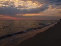 Il tramonto alla spiaggia Fotografia Stock
