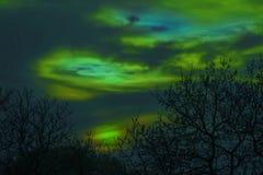 Il tramonto nella luce verde, vede dai noi luci polari, luci del nord fotografia stock libera da diritti