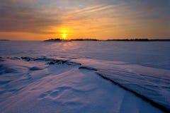 Il tramonto sopra froozen il mare Fotografia Stock
