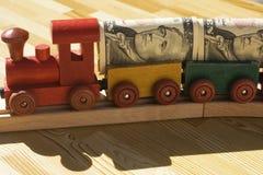 Il treno dei soldi fotografie stock