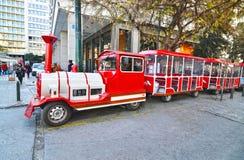 `` Il treno felice di Atene `` al sintagma Grecia della via di Ermou Immagine Stock